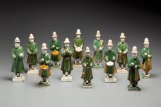 A Set of 15 green Glazed Pottery Figures of Attendants
