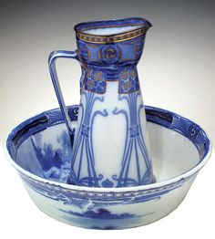 A ROYAL DOULTON ART NOUVEAU PORCELAIN 'AUBREY FLOW' WASHBOWL AND PITCHER.