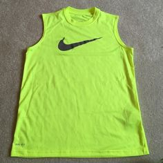 Nike Dri-Fit Tank Volt yellow Nike tank! Boys M but can fit loose for a girl, I'm pictured above in it and I wear S in Nike women's. Worn once and in great condition! Nike Tops Tank Tops