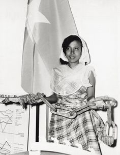 A young Somali Women at a Trade Fair in Milan, Italy in 1964 showcasing a Somali made product.   #vintagesomalia