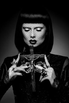 Black and white portrait, crucifix, rings, veil, bangs, bob haircut, dark lips