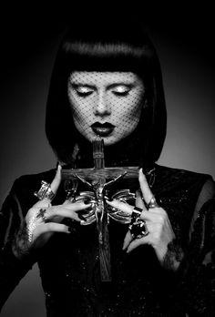 Black and white portrait, crucifix, rings, veil, bangs, bob haircut, dark lips