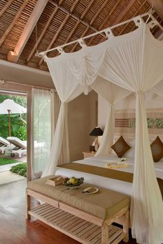 Puri Sunia's Nandini villas come with heavenly canopied beds, Balinese thatched roofs and a private dipping pool - divine!