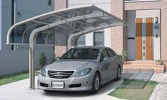 Sankyo Tateyama Aluminum Inc. in Japan manufactures several models of stylish aluminum-framed carports. The elegant KDR series is built to withstand wind speeds of nearly 74 knots and comes standard with blue, brown or clear polycarbonate panels.