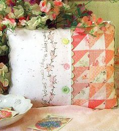 Simple joys of spring pillow — I have a similar printed fabric that I have been wondering what I would do with — problem solved!