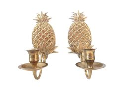 This is a beautiful pair of vintage brass candle holder pineapple wall sconces. These would be perfect for your beach or tropical décor or would compliment your mid century modern pineapple decor. These have a pre drilled hole in the back so they will be ready to hang on your wall.  D E T A I L S:  * Measures: 9 Tall X 3 Wide candle holder sticks out about 3 from the wall  * Condition: These wall sconces are in great vintage condition. These have some patina to the brass and some candle wax…