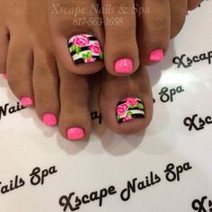 A beautiful rose and stripe inspired toenail art design. The smaller nails are coated in bright pink nail polish while the big toenail is designed with thick black and white stripes. Pretty pink roses are added on top of the stripes and complete the overall flower effect.