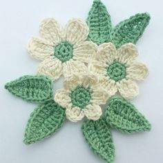 3 cream crochet flowers and 6 green leaves, appliques and embellishments