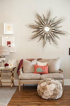 love the silver sunburst mirror and the interesting pouf