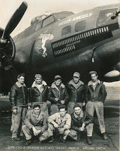 """Aircraft and ground crew of Boeing B-17F-25-BO Fortress """"Hell's Angels"""" (41-24577) of the 358th Bomb Squadron, 303d Bomb Group, RAF Molesworth. This was the first B-17 aircraft to complete 25 combat missions in the 8th Air Force, on 13 May 1943. After completing 48 missions, the aircraft returned to the U.S. on 20 January 1944, for a publicity tour."""