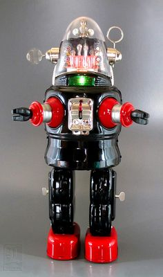 Normura's Mechanized Robot, Robby the Robot from Forbidden Planet. Released less than a year after the debut of the 1956 MGM classic, Nomura's is both the first and most accurate period rendition of the movie robot. Through scores of Robby imitators emerged, none captured the style and action of Nomura's battery-driven 14-inch toy. The real action is inside his head: pistons furiously pump up and down, while the head antennae spin-just like the movie inspiration.