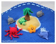 This island play set includes instructions for crocheting the ocean and island base, palm tree, and also a shark, whale, turtle, octopus, and starfish amigurumi.