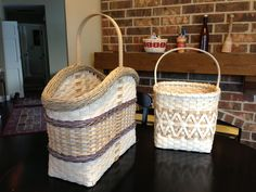 7 and 4. 7-Towering Gretchen Tote featuring a twined arrow weave and a Gretchen braided border. 4-Market Cross basket (Sandy Bulgrin classes)