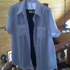 White button blouse Short sleeve with lapel button detail on each sleeve.  Do not roll up. Two pockets. Wear alone or over a shell of any color or print. Looks great!!🌷🌷 XL but it would fit large. Joanna Tops Blouses