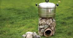 DIY Rocket Stove Out Of Stones And Coat Hangers - SHTF, Emergency Preparedness, Survival Prepping, Homesteading Survival Stove, Survival Food, Camping Survival, Outdoor Survival, Survival Prepping, Survival Kits, Disaster Preparedness, Camping Gear, Diy Rocket Stove