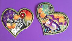 This is a set of two heart appliques handmade with high quality Laurel Burch fabric from her Fabulous Felines collection. These appliques are about the same size and measure approximately 3 1/4 (h) by 3 3/4 (w).  Just peel off the paper backing and iron onto your item of choice (fabric, canvas, card stock, etc...) ~ so many possible uses.  All of my appliques are beautifully hand cut and made with a high-quality iron-on backing. They may be applied to paper (great for scrap booking...