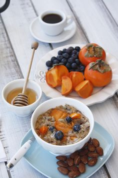 Persimmons & Blueberries by Heaven with or without the oatmeal! (use agave for honey) #Persimmons #Blueberries #Oatmeal