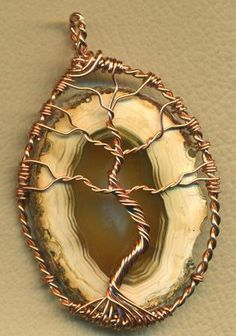 Tree Of Life Agate Copper Wire Wrap Pendant. I've never seen this done with an agate slice. I like...