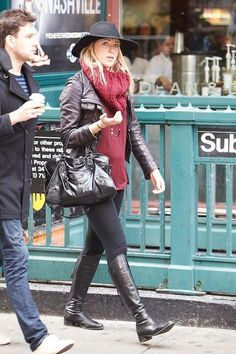 Leggings, boots, leather jacket, and chunky scarf - it's a perfectly layered cold weather outfit (click for more)