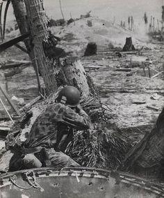 Marine Shoots on a Japanese Pill Box Tarawa November 1943. Credit: USMC.