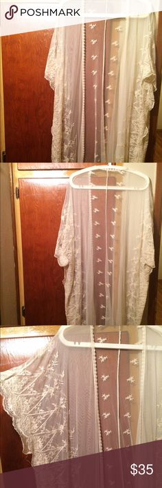 White sheer kimono Medium, white sheer, long embroidered kimono. Falls about mid calf (I'm 5'5). Floral embroidery all down the sides, with lace on the seems. Can be worn over fancy/casual attire, or used as lingerie. No trades please, but willing to negotiate offers Intimates & Sleepwear Robes
