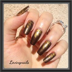 http://lovingnails.wordpress.com/2013/09/16/nail-art-bronze/
