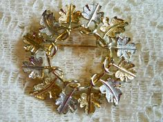 Vintage 1960s Sarah Coventry Garland Leaf Brooch by BlackRain4, $12.99  I have this pin & it's as pretty as the day I bought it !