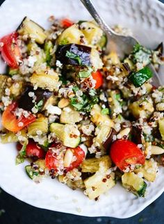 This fresh quinoa salad features amazing Mediterranean flavors, including summer squash, tomatoes, eggplant, basil and mint! Light, healthy and delicious.