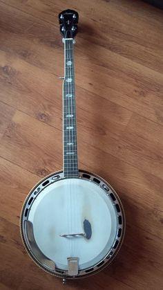 Online veilinghuis Catawiki: Banjo Ariana bluegrass  G-string met bijbehorende koffer.