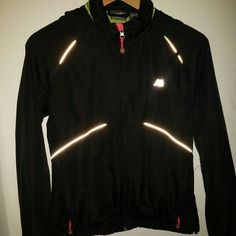 New Balance jacket A nylon black jacket with bright green mesh inside. Has reflective strips for running at night. The jacket has a hoodie that can be folded and put inside a zippered pocket when not in use. Looks very nice as well with hoodie out. It is a size small. No rips or stains and smoke free, pet free enviorment. New Balance Jackets & Coats