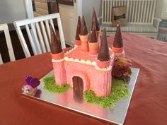 She asked for a pink, chocolate castle cake.  Clear art direction + 2 creative people = 1 happy 4 year old birthday girl. :)