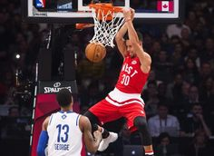 Western Conference's Stephen Curry, of the Golden State Warriors, (30) slam dunks the ball past Eastern Conference's Paul George, of the Indiana Pacers (13) during the first half of the NBA all-star basketball game, Sunday, Feb. 14, 2016 in Toronto.