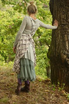 Love long sleeve tees and flouncy skirts, with boots. Too cute. Wish I were this slim though.