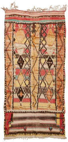 Antique Moroccan Rug with coral accents.