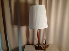 Vintage Mid Century table lamp. Modern long tall wood column, Square brass base…