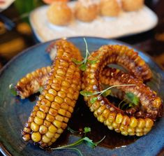 these corn 'ribs' that look every bit as good as their meaty counterparts — the caramelised kernels slathered in black garlic and fermented chilli for a spicy and savoury kick. Garlic Uses, Black Garlic, Menu Planning, Ribs, Spicy, Vegetables, Food, Meal, Veggies