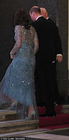 Kate's silver stilettos were visible under the hem of her long blue dress. Nov 24 2017 Kate wearing gorgeous blue and silver embellished gown, third pregnancy. Rear back view walking up steps.