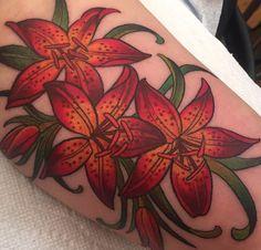 Vibrant tiger lily tattoo by Kim Saigh at Memoir Tattoo