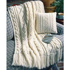 "Number of Projects: 2</p><p><strong>Size:</strong> Afghan 44"" X 59""; Pillow 14"" square</p><p><strong>Designer:</strong> Mary Jane Protus</p><p><strong>Original Publication:</strong> Leisure Arts Leaflet #3049, Our Best Knit Collection</p><p><strong>Description:</strong> This enticing afghan and pillow alternate columns of cables and diamond mot..."