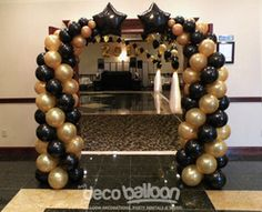 12. Gold and Black Bended Entrance Balloon Columns