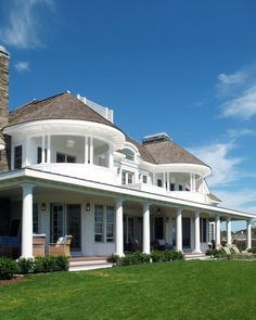 Gorgeous home. I love the big round porches. Maybe having just one around the corner of your house, and off to the side?