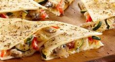 Easy Cheesy Vegetable Quesadillas: Keep flour tortillas on hand so you can prepare quesadillas anytime. Fill with your favorite vegetables and shredded cheese and you will have an appetizer or light meal.
