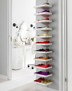 Too many shoes, not enough storage space? Put your shoes on display with an adaptable wall unit like this!