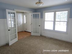 First, it's a board and batten tutorial, second, I love this room!  the colors, the style, love it all