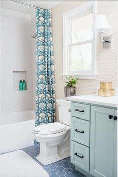 Home Decorating Tips On A Budget Product Scallop Tiles, Mirror Drawers, Blue Bath, Linen Cabinet, Blue Tiles, Cabinet Makers, Cafe Interior, Diy Wall, Colorful Interiors