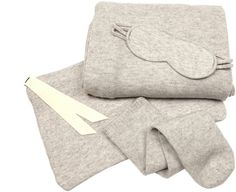 LE KASHA Cashmere travel set. Travel in luxurious comfort with Le Kasha's light-grey melange cashmere set. It features a cosy scarf which can be wrapped around the body like a shawl on long-haul flights slip on socks and a lightly padded double-strap eye mask. And to carry these items? A zip-fastening bag that's accented by a cream grosgrain ribbon.