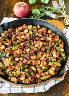 Chicken Apple Sweet Potato Skillet with Bacon and Brussels Sprouts. A healthy one-pan dinner with all of your favorite fall ingredients!