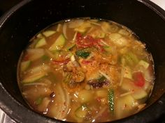 Doenjang jjigae is a kind of stew which made of  soybean paste and tofu, onion and some vegetables.