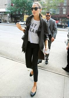 All smiles: The statuesque 5ft 10ins star showed off her long legs in black skinny jeans...