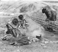 Inuit group making a Kayak - 1919